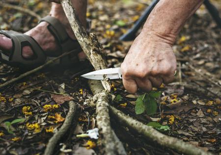 Mature man cutting some firewood