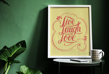 A motivation typography print on the desk against the green wall Reklamní fotografie