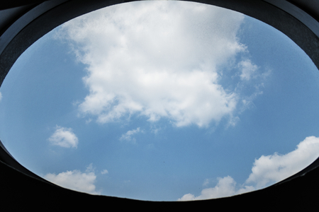 Cloudy blue sky through a window Stock fotó - 109896949