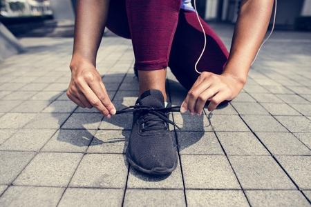 Sporty person checking shoelaces Stok Fotoğraf
