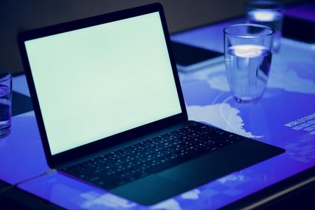 Laptop on a digital desk cyber space