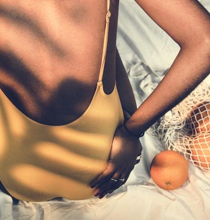 Girl wearing swimsuit in the sunlight Фото со стока