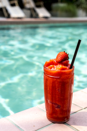 Strawberry smoothie by the swimming pool Stock Photo