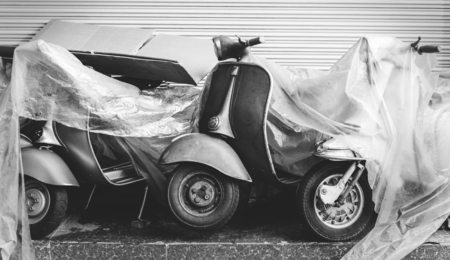 Old scooter parked on a street Banco de Imagens - 110004370