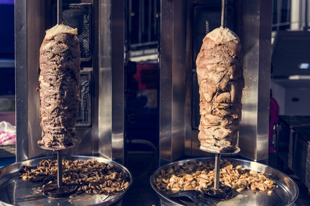 Doner kebab in a roasting spit Stock Photo