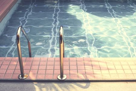Swimming pool in summer time Stock Photo