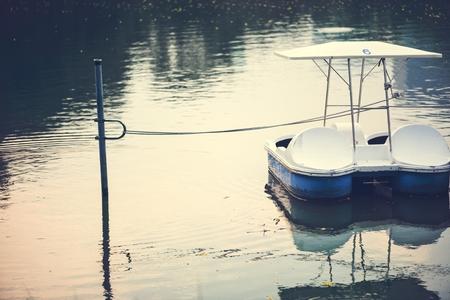 Paddle boat in a dark lake 写真素材 - 110005237