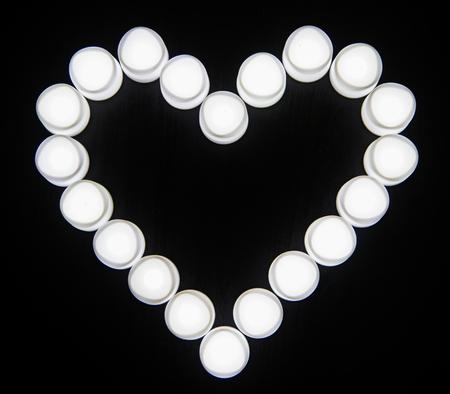 White lights heart shaped icon Archivio Fotografico