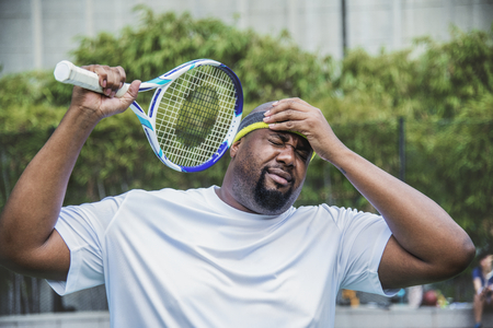 Tennis player losing the match