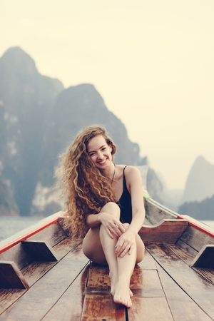 Beautiful woman posing on a boat Stock Photo
