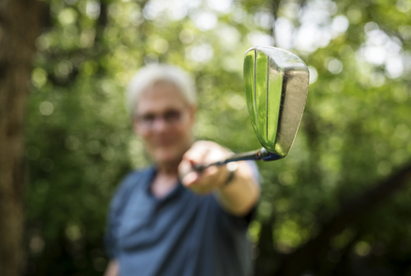 Senior golfer holding a golfclub Archivio Fotografico - 109991715
