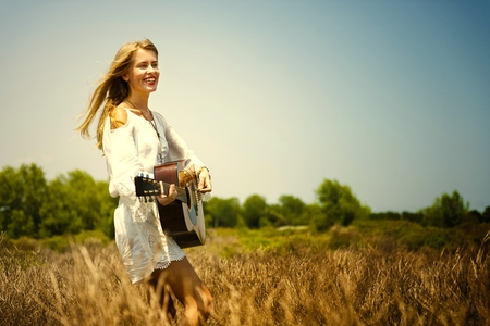 Beautiful singer songwriter with her guitar Stock Photo