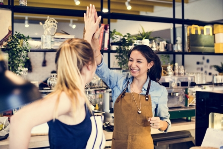 Women give a high five to each other