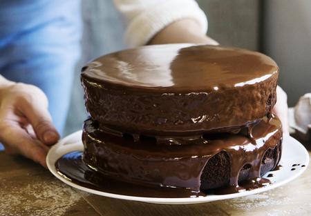 Receptidee voor fotografie van chocolade-toffeescake Stockfoto