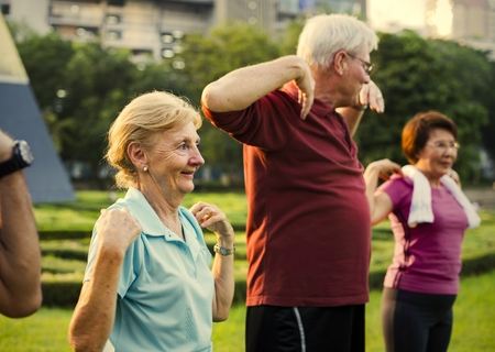 Active seniors working out in the park
