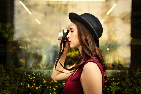 Beautiful woman with a vintage camera Stock Photo