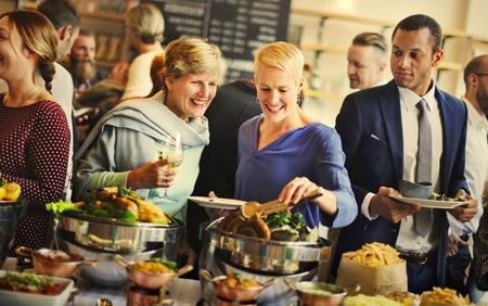 Diverse people at an international dinner buffet Stock fotó