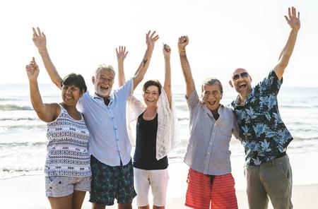 Group of seniors on the beach 写真素材 - 111342784