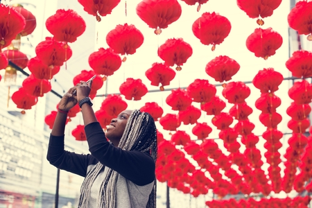 African descent woman selfies with red lamp
