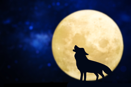Howling wolf silhouette over a full moon Stock Photo - 111767276