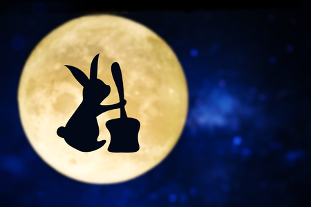 Easter bunny silhouette over a full moon