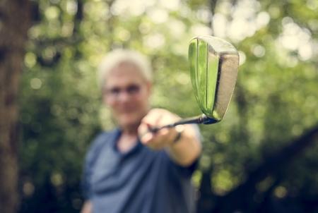 Senior golfer holding a golfclub Archivio Fotografico - 111778650
