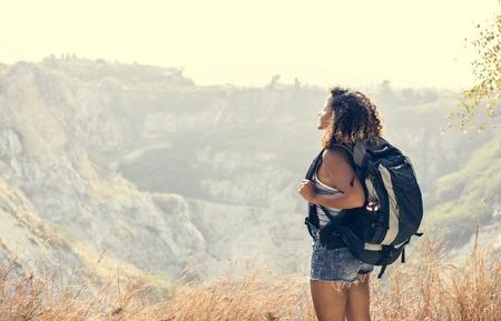 Woman traveler looking at mountain