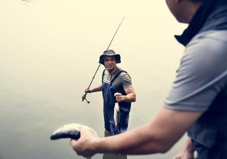 Men fishing at the lake