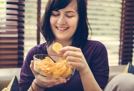 Woman enjoying a bowl of chips