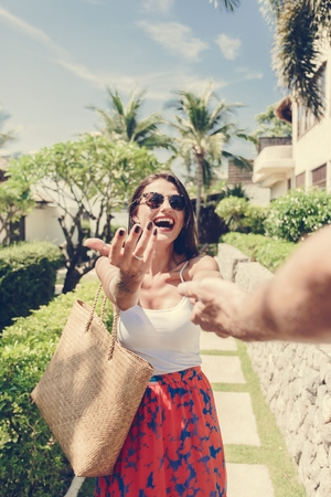 Husband following his wife on a vacation Stock Photo