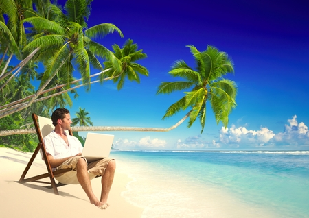 Businessman working remotely from a beach