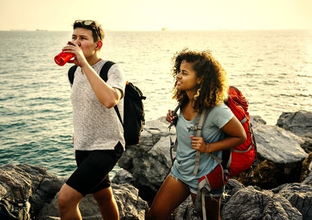 Backpacking friends on a gap year adventure Stock Photo