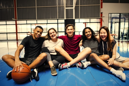 Active friends hanging out at a basketball court