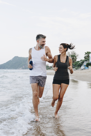 Couple jogging on a beach