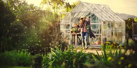 Woman gardening in a greenhouse Foto de archivo