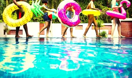 Friends enjoying a pool party Stock fotó
