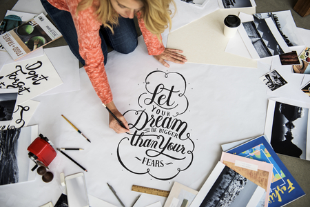 A female artist working on hand lettering project