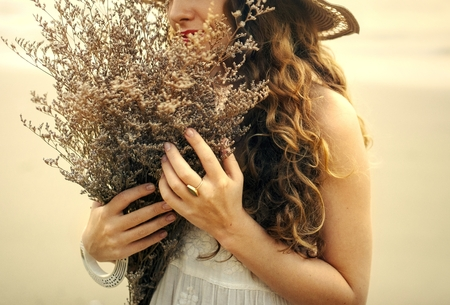 Girl with a bouquet of dried flowers