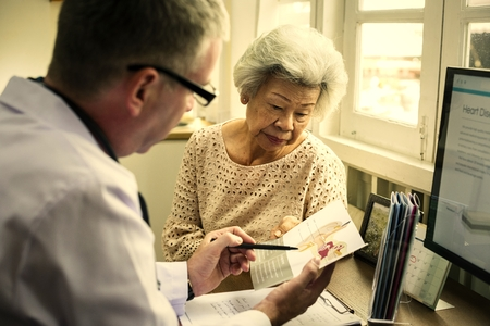 Senior woman talking to a doctor 스톡 콘텐츠 - 110094715
