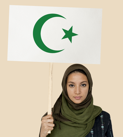 Muslim girl holding a sign