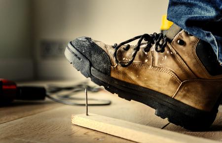 Man stepping on a nail
