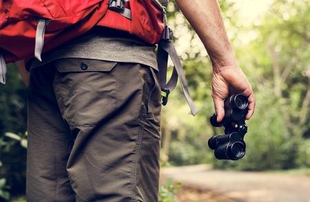 Man holding binoculars in the forest Stock fotó