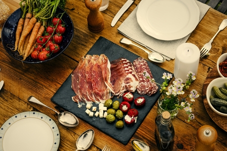 Dinner table set in the garden 免版税图像