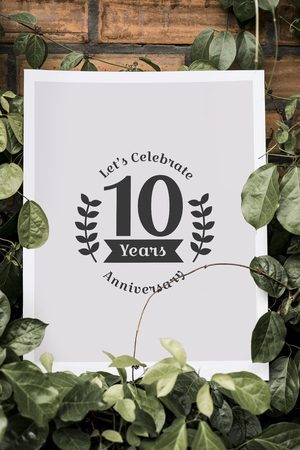 White poster among greenery mockup Фото со стока