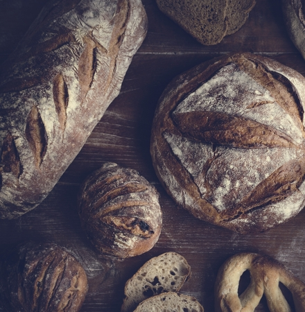 An assortment of bread loaves food photography recipe ideas Stock Photo
