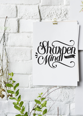 Hand lettering poster on the white wall Stock Photo