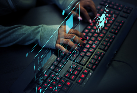 Programmer working to prevent computer virus Stock Photo