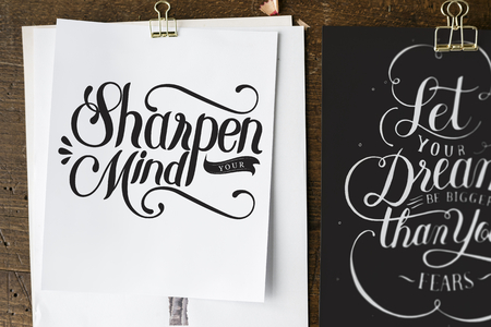 Hand lettering of motivation quote on sketch sheets