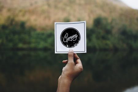 Traveler holding up a note in nature mockup Banco de Imagens - 110105223