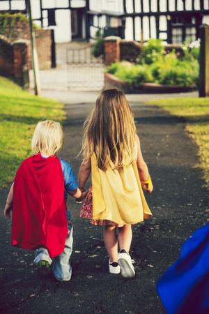 Superheroes walking hand in hand